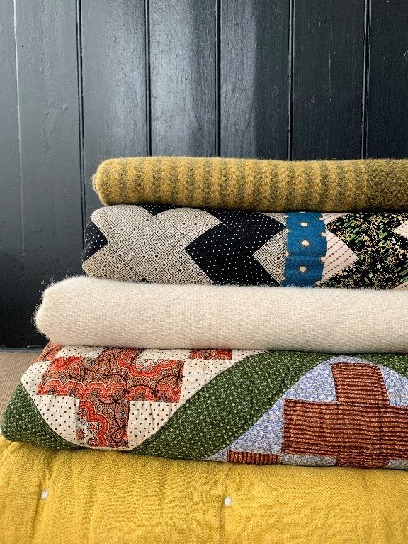 Tinsmiths blankets and throws